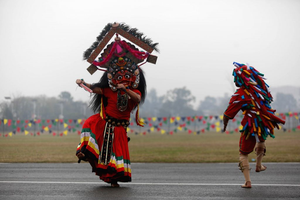 KATHMANDU, Feb. 19, 2019 - Masked dancers perform during the National Democracy Day celebration at Tundikhel in Kathmandu, Nepal, Feb. 19, 2019. Nepal's 69th National Democracy Day was observed on ...