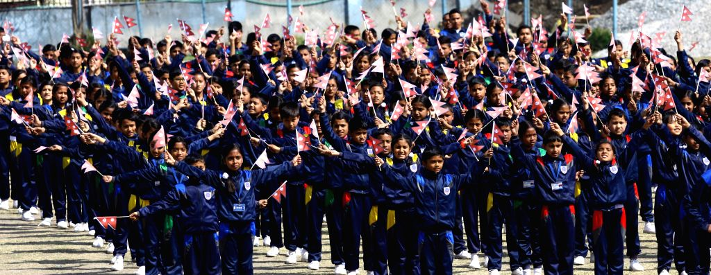 Nepalese children attend a sports program to mark the National Democracy Day in Kathmandu, Nepal, Feb. 19, 2015. Nepal observed the 65th National Democracy Day on ...