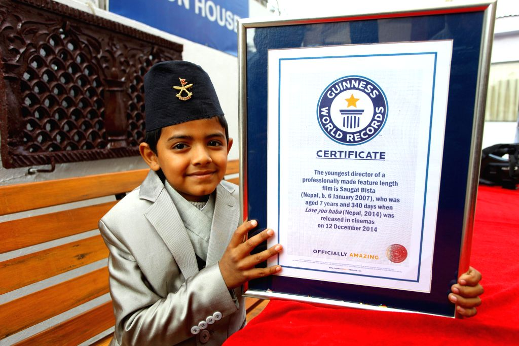 Nepalese eight-year-old kid Saugat Bista shows the certificate of Guinness World Records for World's Youngest Director in Kathmandu, Nepal, Feb. 20, 2015. Bista ...