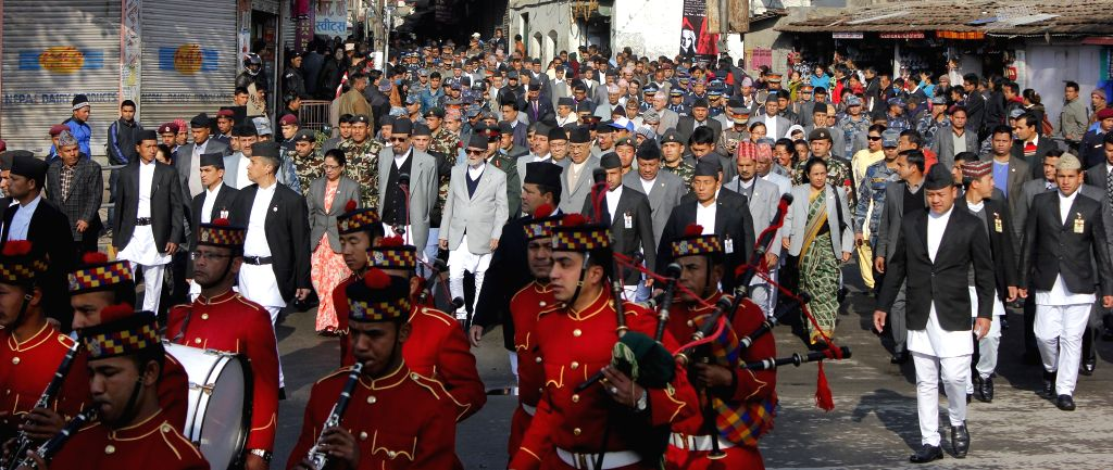 Nepalese officials participate in a rally to mark the National Democracy Day in Kathmandu, Nepal, Feb. 19, 2015. Nepal observed the 65th National Democracy Day on ...