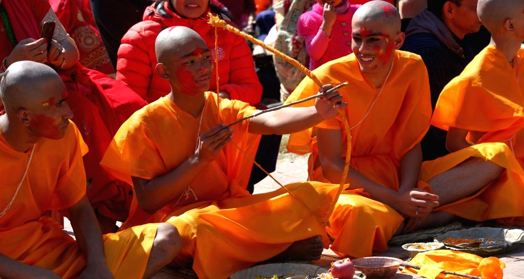 KATHMANDU, Feb. 22, 2019 - Hindu boys attend a religious ritual during the Bratabandha ceremony in Kathmandu, Nepal, Feb. 21, 2019. As a tradition, Nepalese Hindu young boys shaved their heads during ...