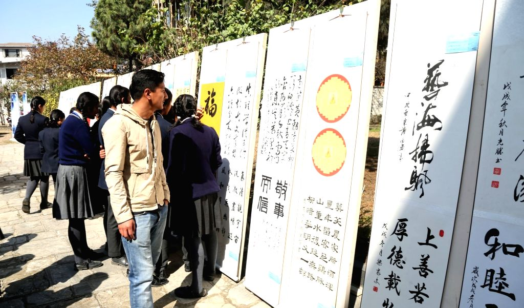 "KATHMANDU, Feb. 22, 2019 - People visit ""Ode to Hope: Painting and Calligraphy Exhibition of Teachers and Students in China and Nepal"" in Kathmandu, Nepal, Feb. 21, 2019. The one-day ..."