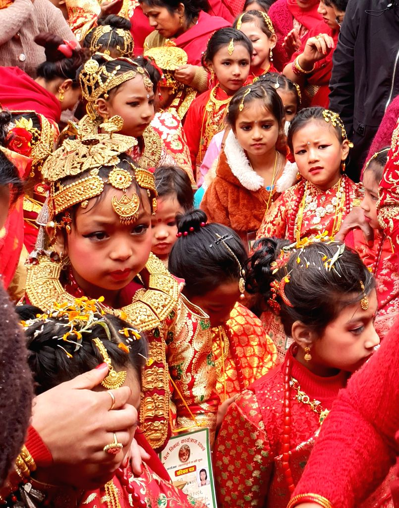 KATHMANDU, Feb. 9, 2019 - Girls from Newar community attend a Bel Bibaha ceremony in Kathmandu, capital of Nepal, Feb. 9, 2019. Bel Bibaha, or Ihi, is a marriage ceremony in the Newar community of ...