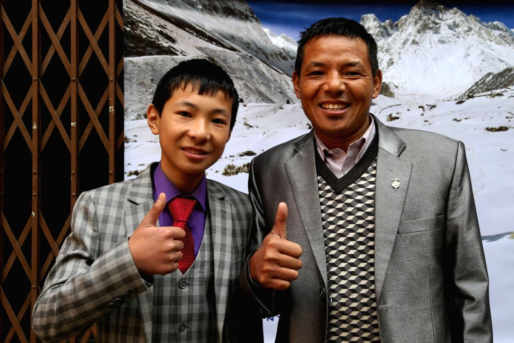 KATHMANDU, Feb. 9, 2019 - P.K Sherpa (R) and Sonam Sherpa give thumbs up during a press conference in Kathmandu, capital of Nepal, Feb. 9, 2019. P.K Sherpa and his 14 year-old-son Sonam Sherpa will ...