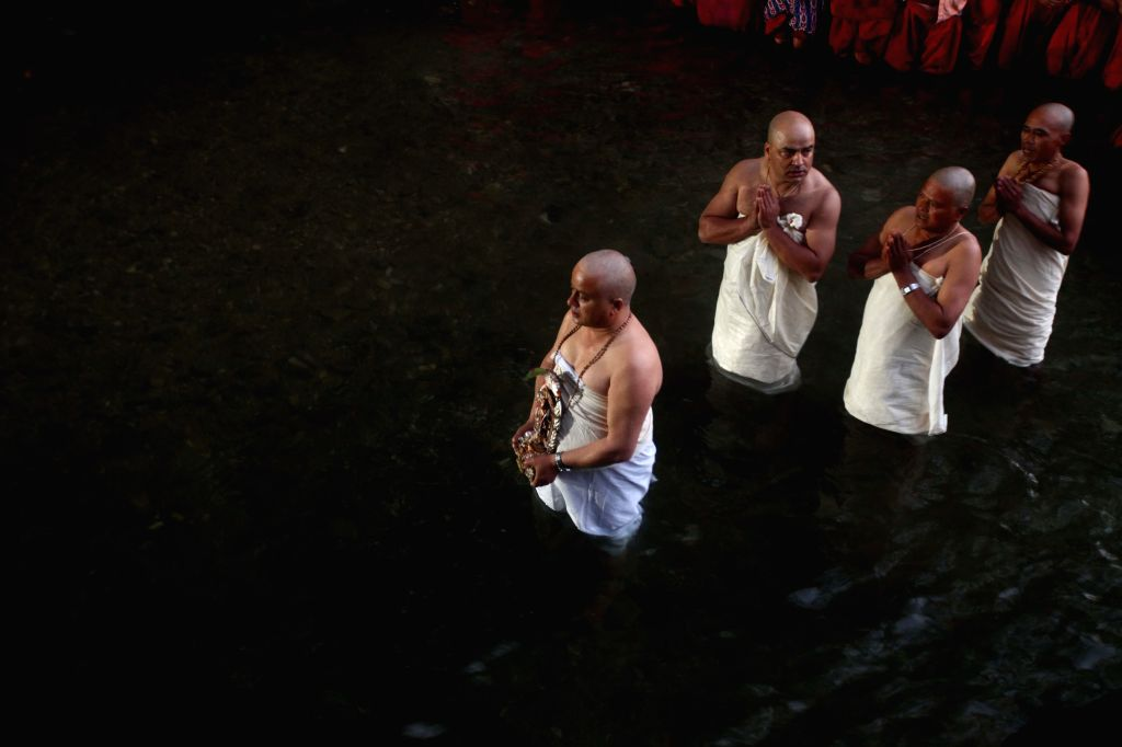 Nepalese Hindu men worship in the holy Shalinadi River on the first day of Madhav Narayan festival at Sankhu in Kathmandu, Nepal, Jan. 5, 2015. Nepalese Hindu ...