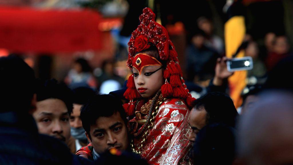 Nepalese Living Goddess Kumari observes the rituals during Changu Narayan festival in Kathmandu, Nepal, Jan. 5, 2015. The idol of Changu Narayan is brought to ...
