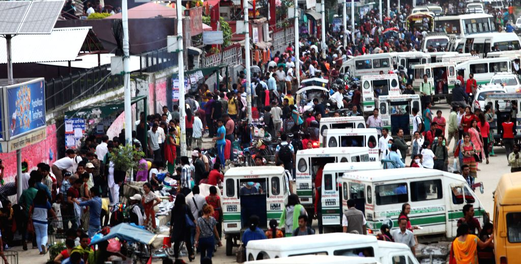 """KATHMANDU, July 12, 2016 - A large number of people are seen at a bus station in Kathmandu, capital of Nepal, on July 11, 2016, the World Population Day whose theme of this year is """"Investing in ..."""