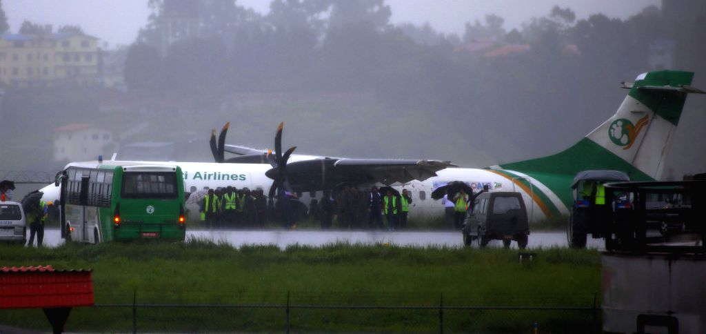 KATHMANDU, July 12, 2019 (Xinhua) -- Photo taken on July 12, 2019 shows an aircraft of Yeti Airlines after it skidded off the runway at Tribhuvan International Airport in Kathmandu, Nepal. All passengers and crew members on the domestic flight were r - Sunil Sharma