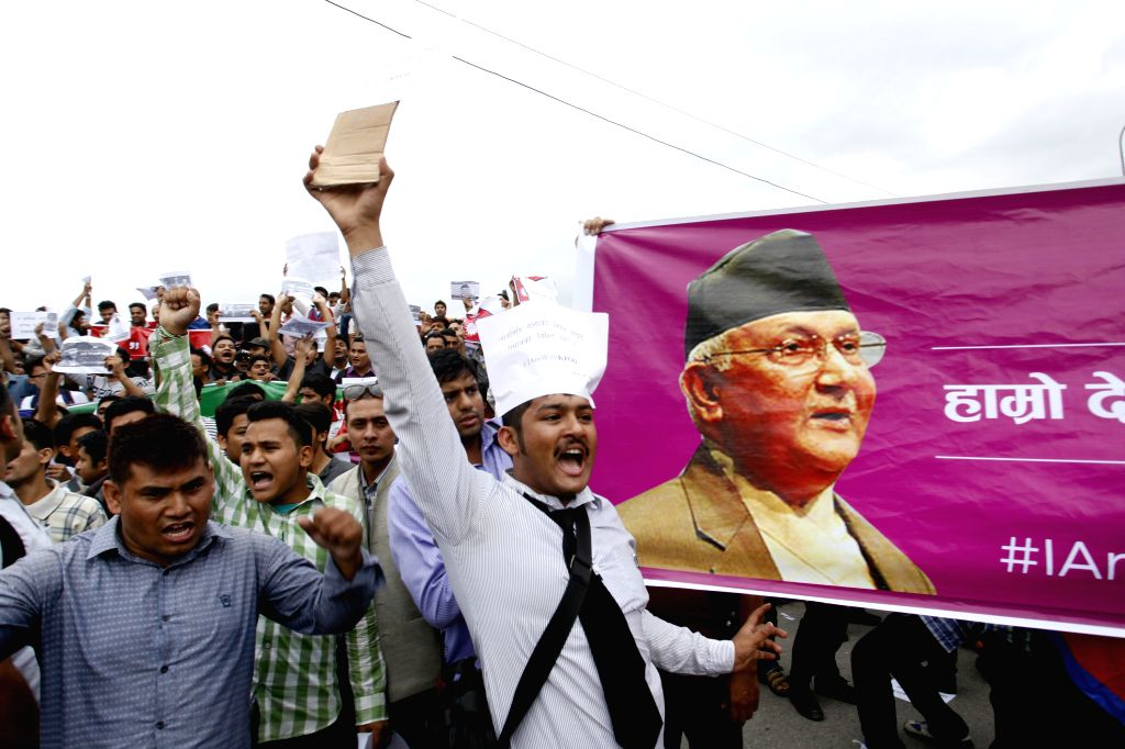 KATHMANDU, July 15, 2016 - Nepalese youths shout slogans during the rally organized to support Prime Minister KP Oli and against the decision made by CPN (Maoist-Centre) to withdraw the support from ... - K
