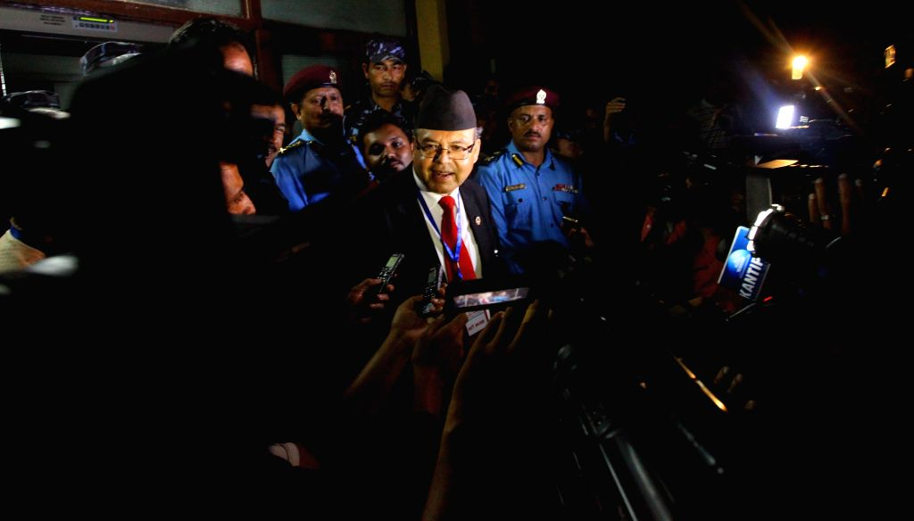 Jhala Nath Khanal (C), chairman of the Communist Party of Nepal (United Marxist-Leninist), speaks to the media after KP Oli was elected as the party's new ... - Jhala Nath Khanal