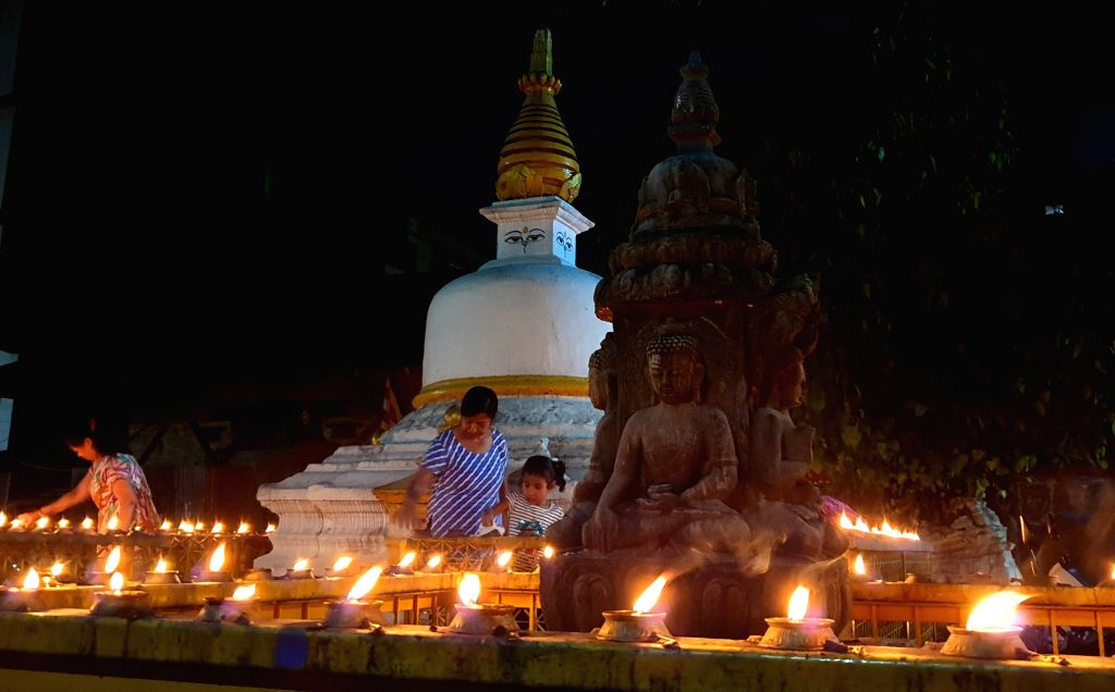 KATHMANDU, July 17, 2019 - People light oil lamps to offer prayers on full moon day in Kathmandu, Nepal, July 16, 2019.