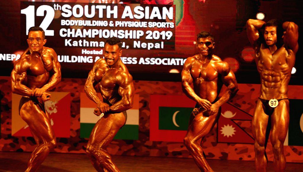 KATHMANDU, July 19, 2019 - Bodybuilders pose during the 12th South Asian Bodybuilding Championship 2019 in Kathmandu, Nepal on July 19, 2019.