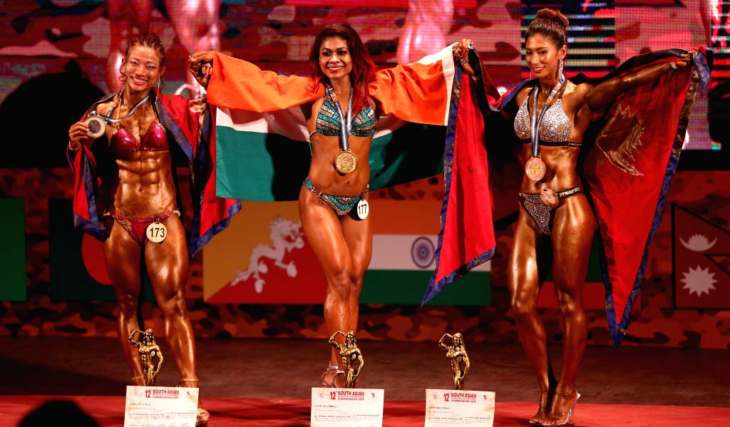 KATHMANDU, July 19, 2019 - Winners pose with their national flags during the awarding ceremony after the 12th South Asian Bodybuilding Championship 2019 in Kathmandu, Nepal on July 19, 2019.