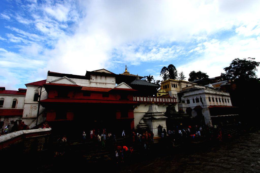 Hindu devotees offer prayers on Shrawan Somvar at Pashupatinath temple in Kathmandu, Nepal, July 21, 2014. Shrawan Somvar (Monday) is considered auspicious for ...