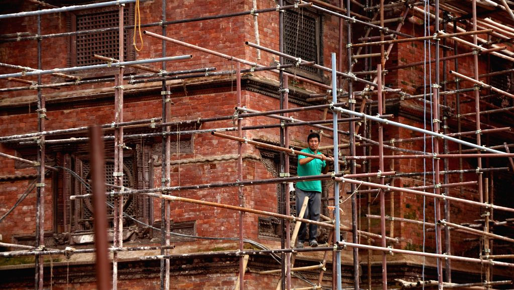 KATHMANDU, July 21, 2016 - A worker works at a reconstruction site of a damaged temple at Hanumandhoka Durbar Square, a UNESCO heritage site in Kathmandu, Nepal, July 20, 2016. Heritage monuments in ...
