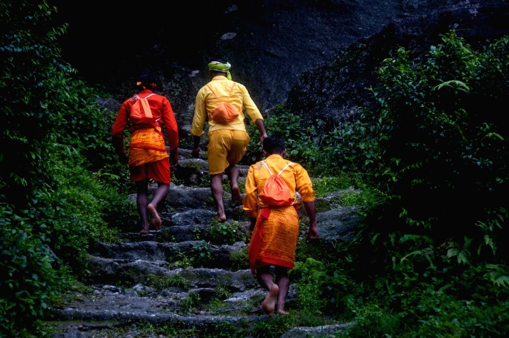 Nepalese Hindu devotees head towards the sacred place to collect water from the Bagmati River during the Bol Bom pilgrimage at Sudarijaal on the outskirts of ...