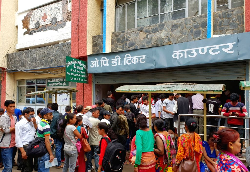 KATHMANDU, July 23, 2018 - Nepalese people queue to get tickets for checkup at Bir Hospital in Kathmandu, Nepal, July 22, 2018. Medical services were largely affected across Nepal including the ...