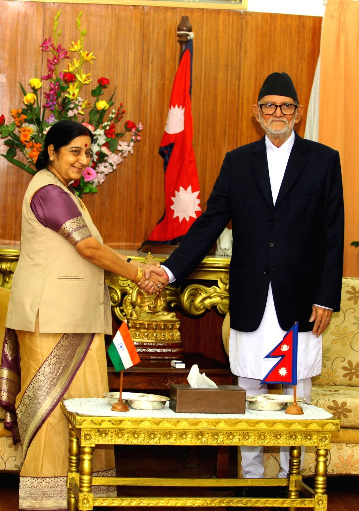 India's Minister for External Affairs Sushma Swaraj (L) shakes hands with Nepalese Prime Minister Sushil Koirala during her visit for the 3rd Nepal-India Joint ... - Sushil Koirala and Sushma Swaraj