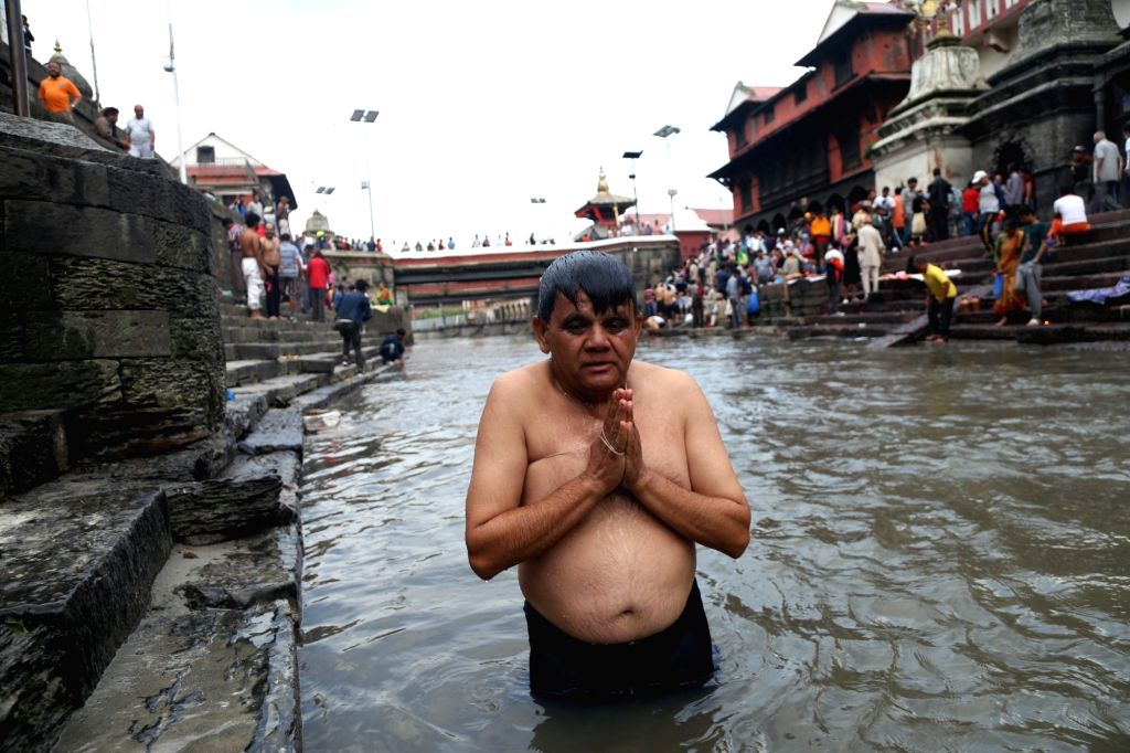 KATHMANDU, July 28, 2017 - A Hindu devotee offers prayers during the Janai Purnima Festival at bank of Bagmati river in Kathmandu, Nepal, July 28, 2017. Janai Purnima, also known as the festival of ...