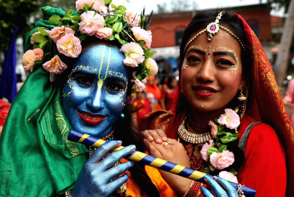 KATHMANDU, July 29, 2016 - Nepalese devotees dressed up as Lord Krishna and Goddess Radha participate in the procession of the Rath Yatra or Chariot festival in Kathmandu, Nepal on July 28, 2016. ...