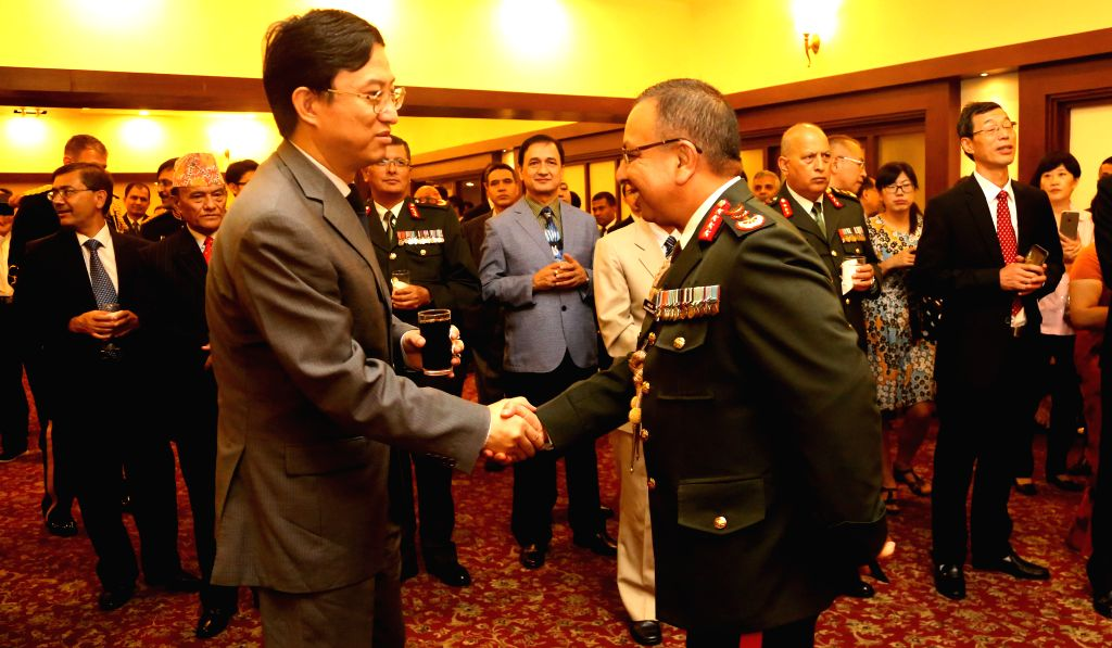 KATHMANDU, July 30, 2016 - Chinese Ambassador to Nepal Wu Chuntai (L) shakes hands with Nepalese Chief of Army Staff (CoAS) Rajendra Chhetri during a reception celebrating the 89th Anniversary of ...