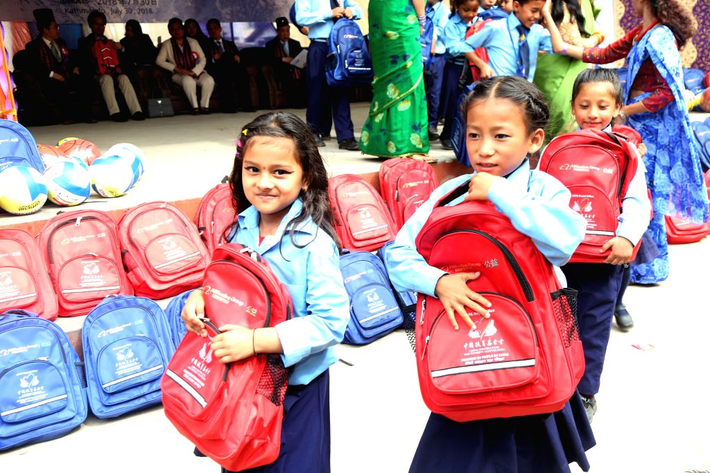 KATHMANDU, July 30, 2018 (Xinhua) -- School kids receive bags and stationery items in Kathmandu, Nepal, July 30, 2018. As part of endeavor to support Nepal's education, two non -governmental organizations (NGOs) from China on Monday distributed schoo - Sunil Sharma
