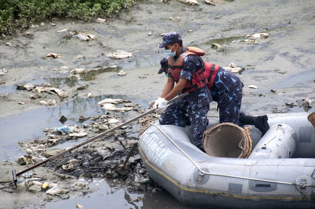 Nepalese soldiers clear trash on the Bagmati River as part of the Save Bagmati Campaign in Kathmandu, Nepal, July 5, 2014. The Bagmati River, also known as Hindu's