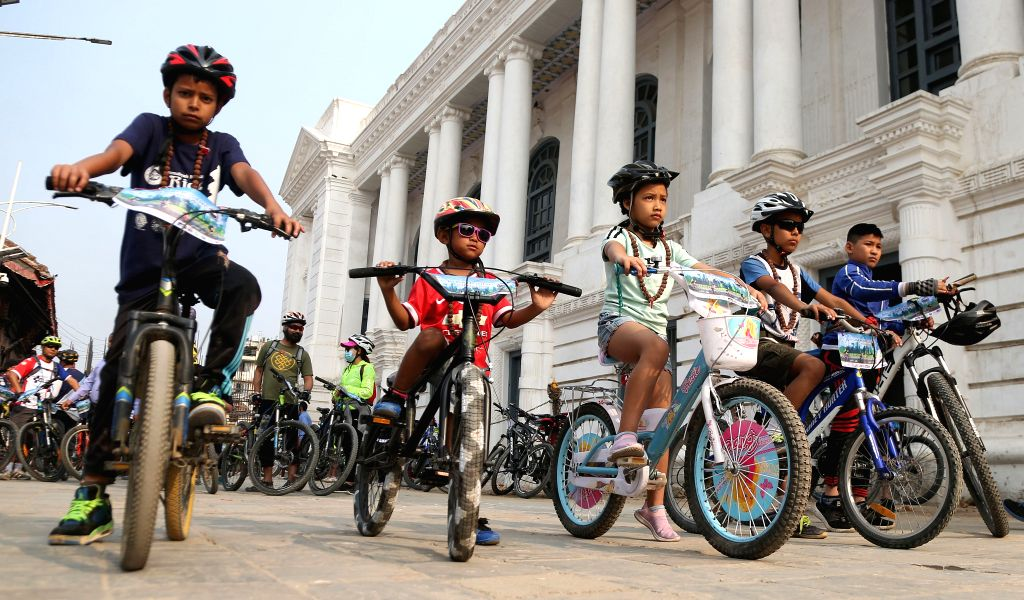 "KATHMANDU, June 1, 2019 - Nepalese kids participate in a cycle rally to mark the ""World Bicycle Day"" at Hanumandhoka Durbar Square in Kathmandu, Nepal, June 1, 2019. More than 100 people ..."