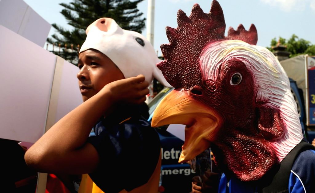 KATHMANDU, June 14, 2019 - Activists wearing mask of animals attend a protest rally against the animal sacrifices in Kathmandu, Nepal, June 14, 2019.