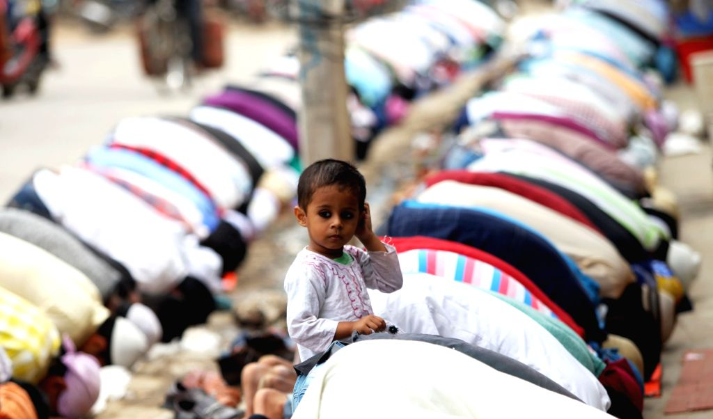 KATHMANDU, June 16, 2017 - A boy stands among Muslims offering prayers during the holy month of Ramadan in front of a mosque in Kathmandu, Nepal, June 16, 2017.
