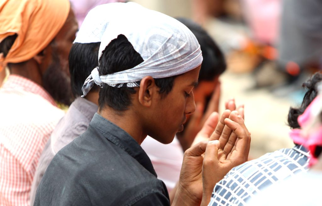 KATHMANDU, June 16, 2017 - A Muslim boy prays during the holy month of Ramadan in front of a mosque in Kathmandu, Nepal, June 16, 2017.