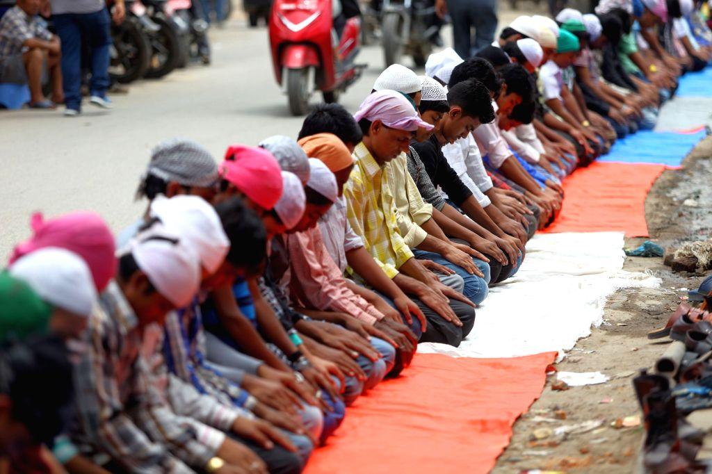 KATHMANDU, June 16, 2017 - Muslims pray during the holy month of Ramadan in front of a mosque in Kathmandu, Nepal, June 16, 2017.