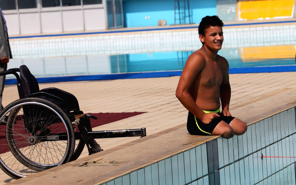 KATHMANDU, June 17, 2016 - A boy prepares to compete in the 4th National Disabled Swimming Competition and Awareness Program organized by Nepal Spinal Cord Injury Sports Association in Kathmandu, ...