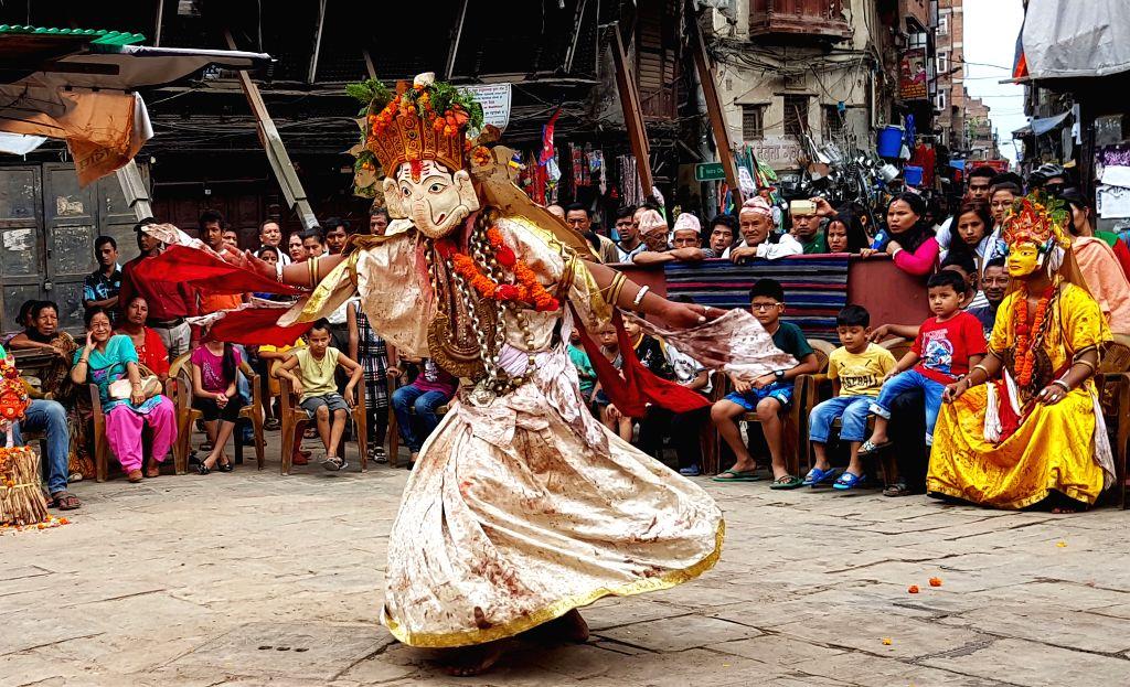 KATHMANDU, June 19, 2016 - A devotee dressed up as a Hindu deity performs a religious dance during the Bhadrakali Khadga Siddhi Jatra in Kathmandu, Nepal, June 18, 2016. The festival is celebrated ...
