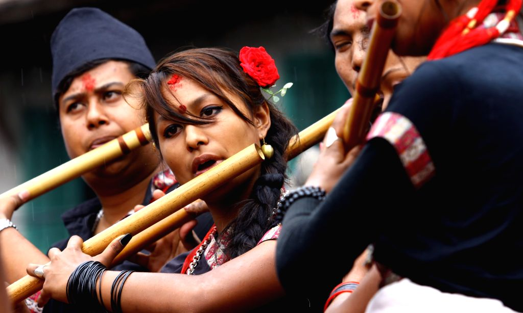 Nepalese young people play flutes at Hanumandhoka in Kathmandu, Nepal, June 21, 2014.