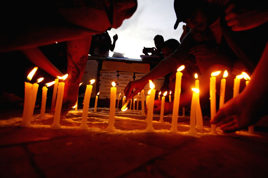KATHMANDU, June 23, 2016 - Nepalese  people light candles to memorize victims killed in the suicide bomb attack in Afghanistan, in Kathmandu, Nepal, June 23, 2016. 12 Nepalese nationals were killed ...