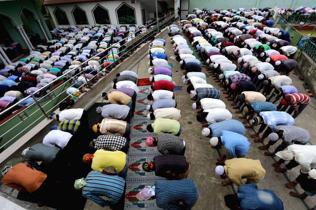 KATHMANDU, June 25, 2016 - Muslims offer prayers during the third Friday of the Islamic holy month of Ramadan at a Mosque in Kathmandu, Nepal, June 24, 2016.