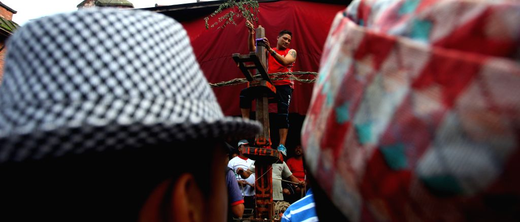 KATHMANDU, June 29, 2016 - A local prepares a chariot to balance the children above a prong for the celebration of Trishul Jatra festival at Jayabageshwori in Kahmandu, Nepal, June 28, 2016. The ...
