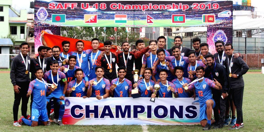 Kathmandu: Kathmandu: India's U-18 team and coaching staff pose with SAFF U-18 Trophy after they defeated Bangladesh in the final of SAFF U-18 Championship in Kathmandu, Nepal on Sep 29, 2019. (Photo: IANS)