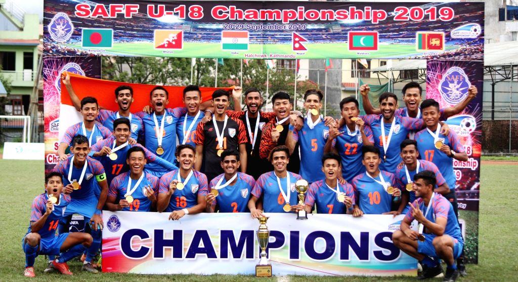 Kathmandu: Kathmandu: India's U-18 team pose with SAFF U-18 Trophy after they defeated Bangladesh in the final of SAFF U-18 Championship in Kathmandu, Nepal on Sep 29, 2019. (Photo: IANS)