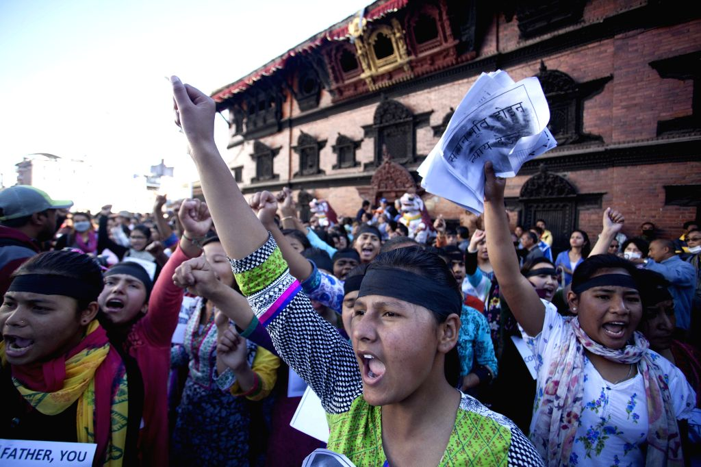 Nepalese women shout slogans during a protest against the death of a six-year-old girl who was reportedly raped in her village a few days ago in Kathmandu, ...