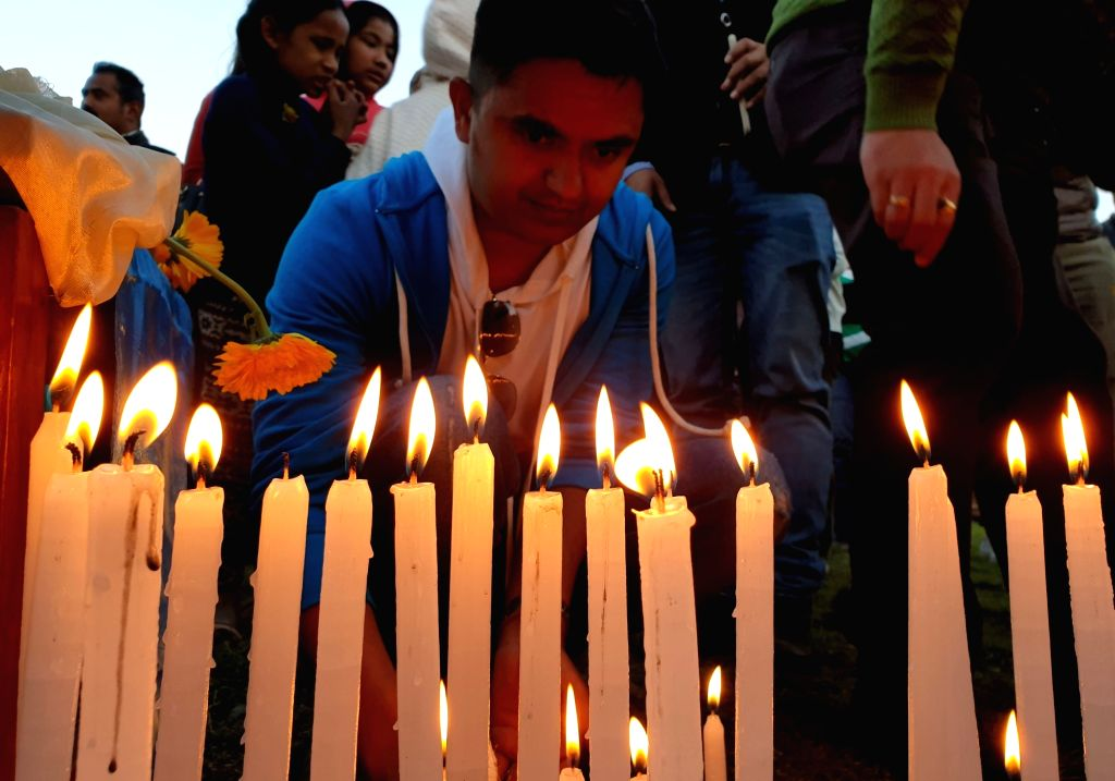 KATHMANDU, March 11, 2019 - A man lights candles during the candlelight vigil in memory of victims of helicopter crash in Kathmandu, Nepal, March 11, 2019. People participated in a candlelight vigil ... - Rabindra Adhikari