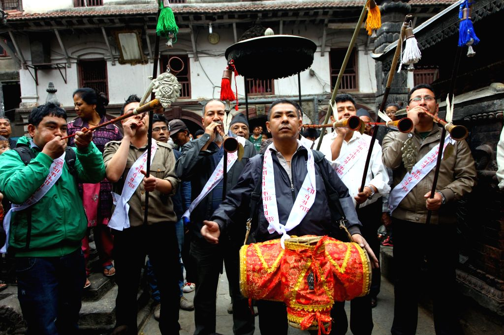 People play traditional music during a procession to mark the beginning of Seto Machhindranath Chariot festival in Kathmandu, Nepal, March 27, 2015. Rato ...