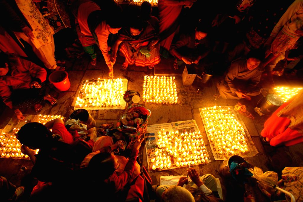 Nepalese devotees light butter lamps during the Seto Machhindranath Chariot festival in Kathmandu, Nepal, March 27, 2015. Rato Machhindranath is known as the god ...