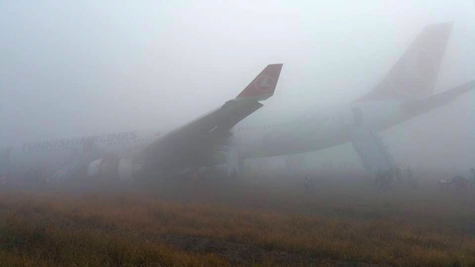 A Turkish Airlines plane lies on the field at Tribhuwan International Airport in Kathmandu, Nepal, March 4, 2015. Turkish Airlines Flight TK 726 skidded off the ...
