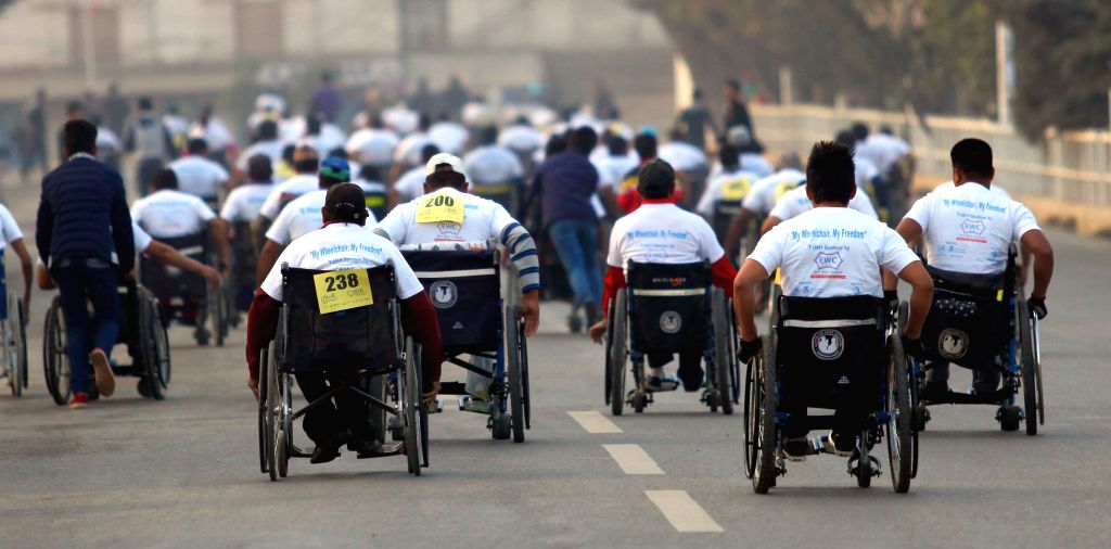 "KATHMANDU, March 4, 2017 - Disabled people compete in the 4km ""Wheelchair Marathon"" in Kathmandu, Nepal, March 4, 2017. The marathon was organized to motivate the disabled people and ..."