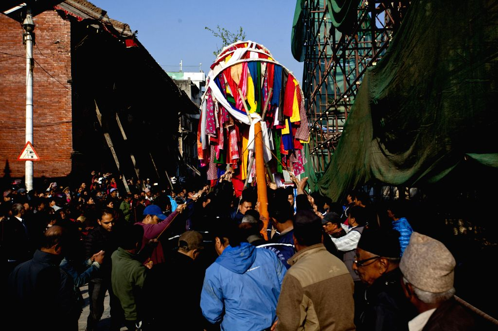 """KATHMANDU, March 5, 2017 - Nepalese people hoist a colorful pole known as """"chir"""" to mark the beginning of the week-long Holi festival in Kathmandu, Nepal, March 5, 2017. Holi, also known as ..."""