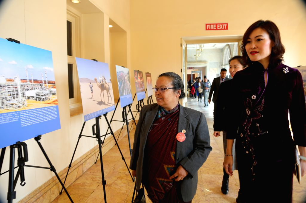 KATHMANDU, March 8, 2019 - Nepal's Minister of Women, Children and Senior Citizen Tham Maya Thapa (L) is accompanied by Chinese Ambassador to Nepal Hou Yanqi (R) while viewing a photo exhibition on ...