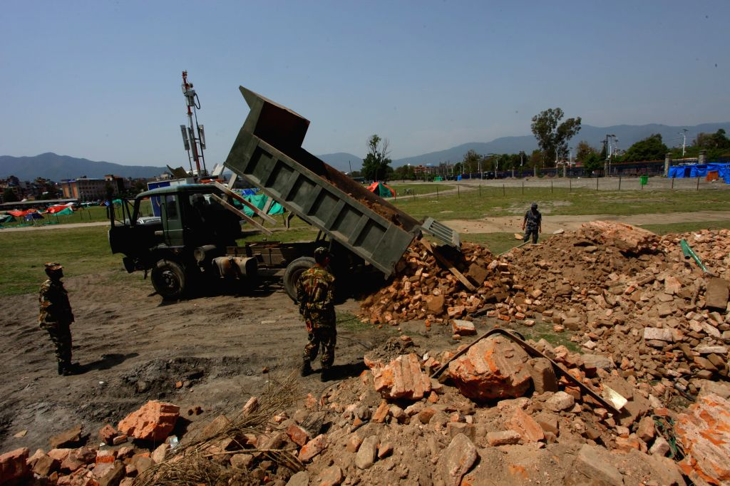 Nepal Army personnel place rubbles of the famous monument Dharahara after clearing from the damaged place in Kathmandu, Nepal, May 1, 2015. The death toll from a ...
