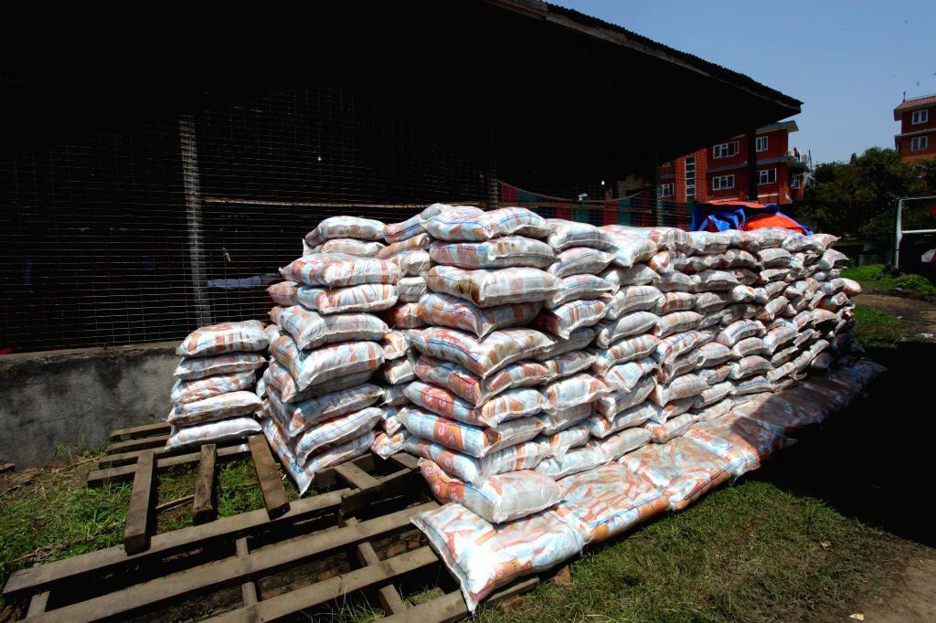 Photo taken on May 1, 2015 shows salt sacks to be distributed at a relief distribution center in Kathmandu, Nepal. The death toll from a powerful earthquake in ...